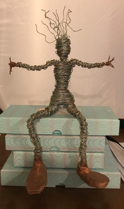 sitting wire man