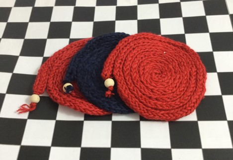 finger knitted coasters