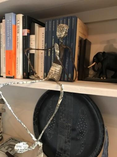 finished sitting figure on bookshelf