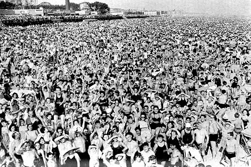Crowded beach scene at Coney Island
