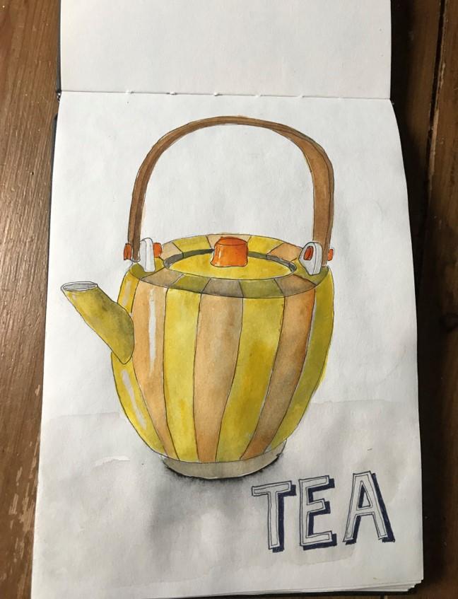 yellow tea pot